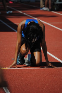 Alexis Williams in the blocks for the 100m sprint